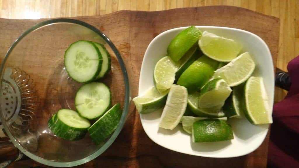 cucumbers and limes in a bowl waiting to become a cucumber lime dirnk