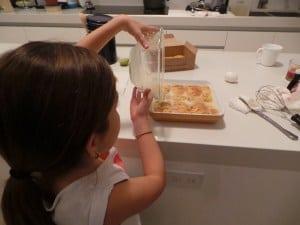 Pouring mixture over cornbread
