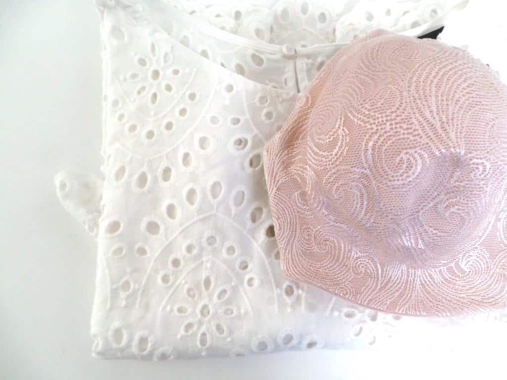 White broderie blouse with blush undercover slimming bra