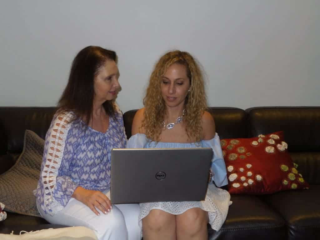 Mother and daughter configuring Dell Inspiron