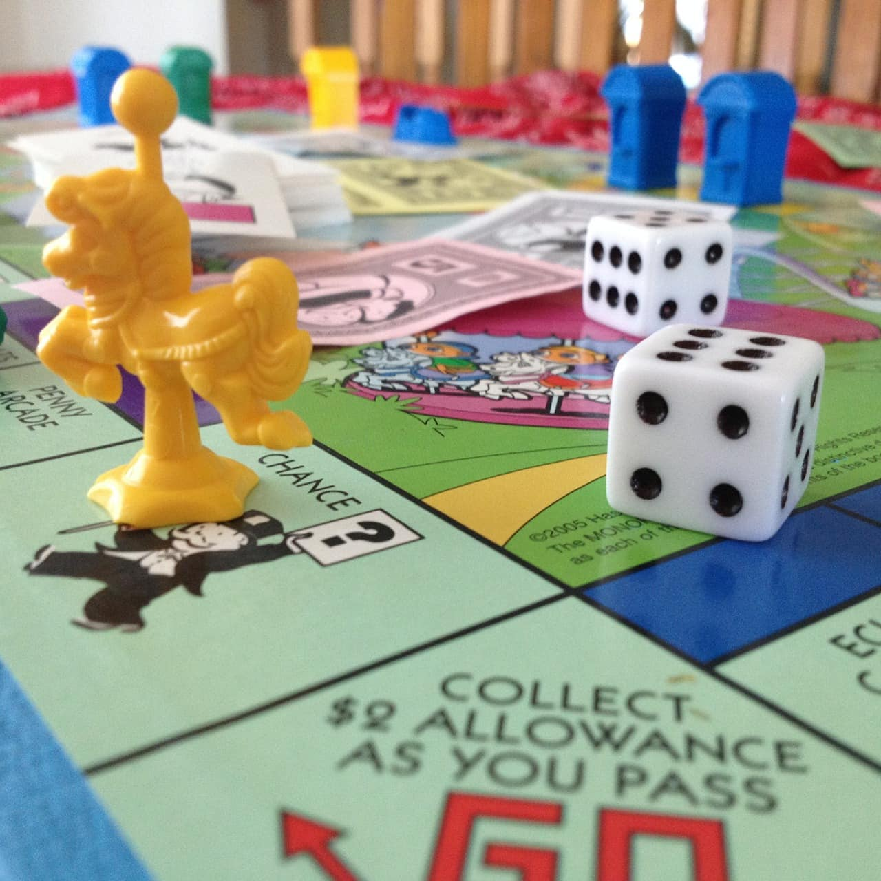 Use games like Monopoly to begin teaching your kids about savings and money
