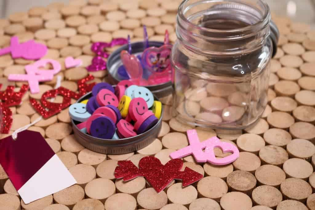 Easy and adorable non-candy Valentine's Day treat for kids requires no candy, just a Mason jar, stickers, stamps and erasers. Super inexpensive!