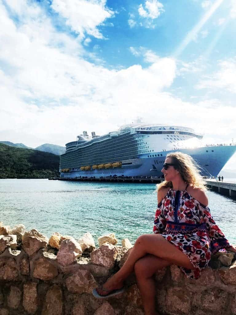 Woman sitting in front of cruise ship
