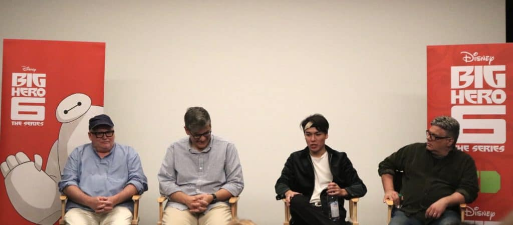 Actor Ryan Potter and Big Hero 6 executive producers Mark McCorkle, Bob Schooley