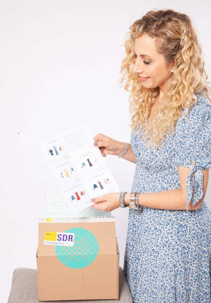 woman displaying stitch fix box