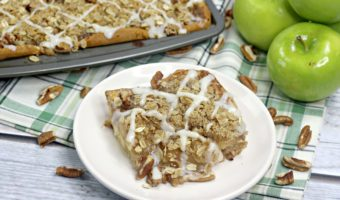 This delicious combination of apples, pecans, cinnamon rolls and butter makes a delectable cinnamon apple slab pie that is a crowd pleaser!