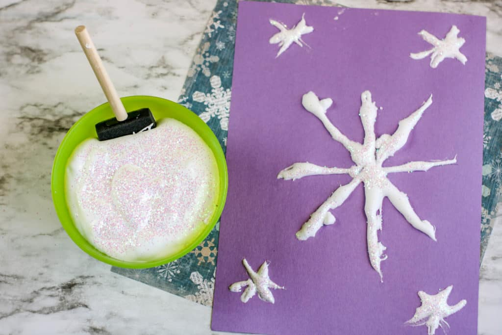 How to make sparkly snow paint to keep kids entertained at home. Perfect activity for a rainy or snowy day!