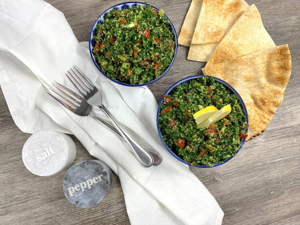Homemade tabbouleh salad with pita bread