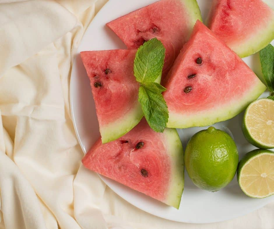 Watermelon slices and limes