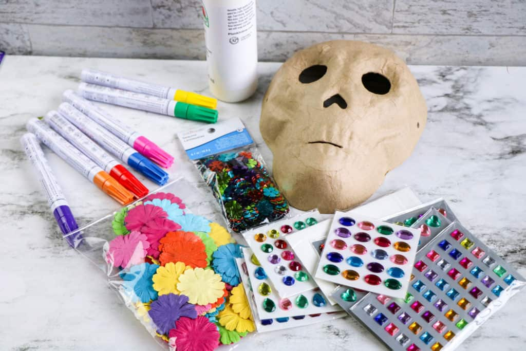 Supplies needed to decorate a Day of the Dead skull