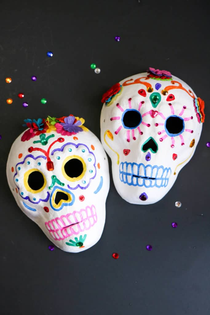 If you celebrate the Day of the Dead or Día de los Muertos, have the children make calaveras or skulls. Here is an easy craft that will look beautiful on any altar.