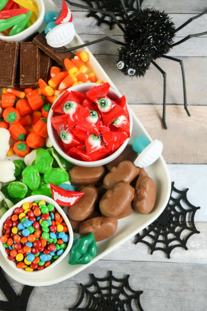 This colorful Halloween candy charcuterie board is the perfect way to serve spooky treats. It's also so easy to make!