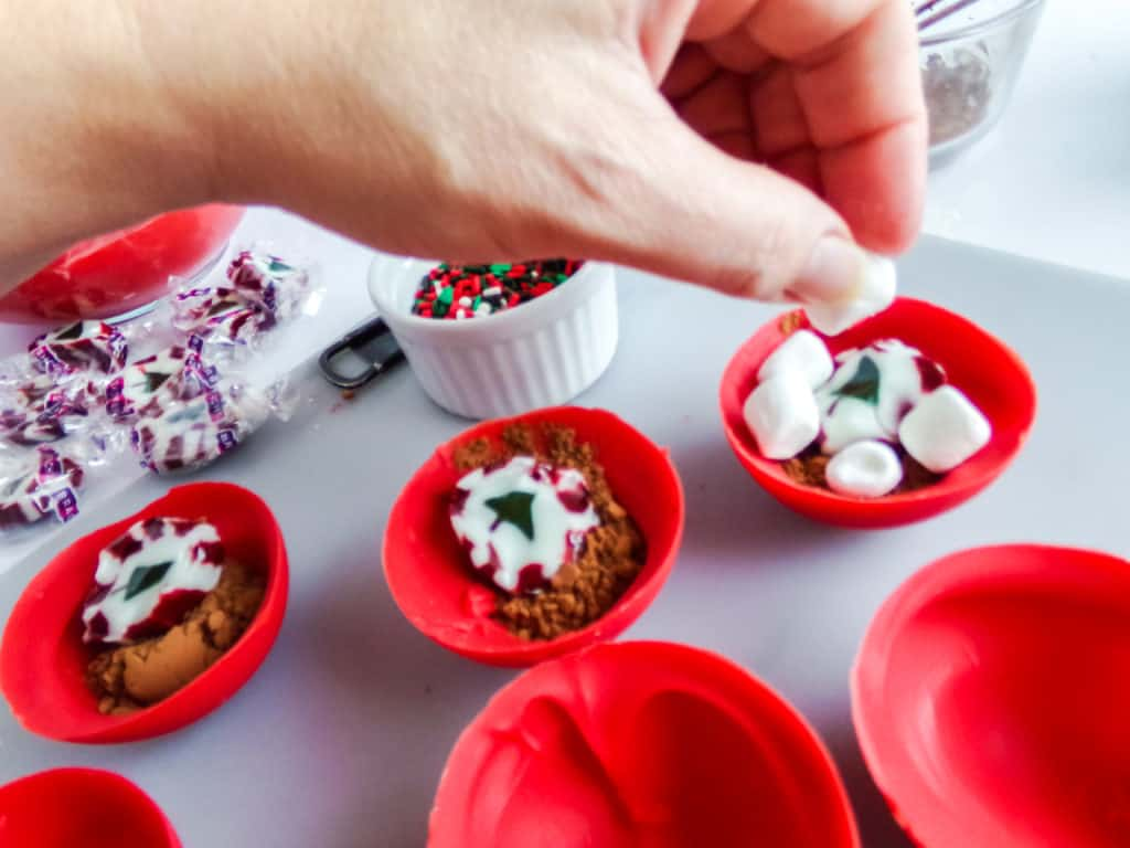 These are the most festive hot cocoa bombs you can make at home. They have hot chocolate, marshmallows, and nougat to create a delightful explosion of flavor and color.