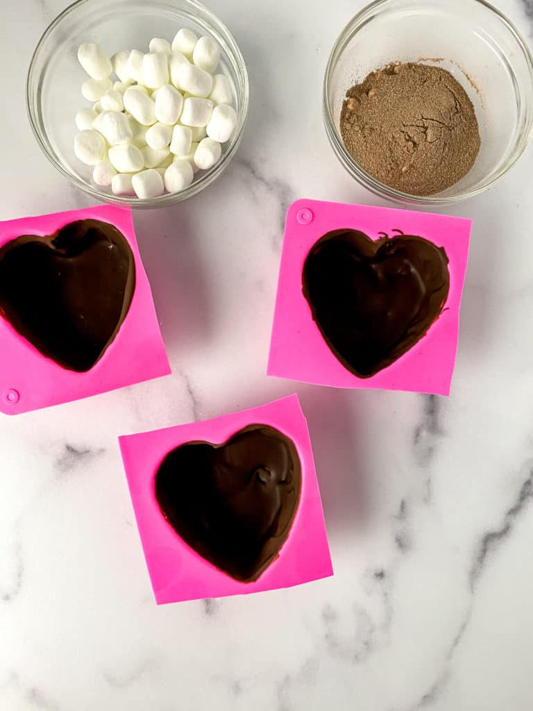 Celebrate Valentine's Day with these decadent heart-shaped hot cocoa bombs. Make them yourself and then enjoy them with a warm mug with your favorite milk or dairy substitute.
