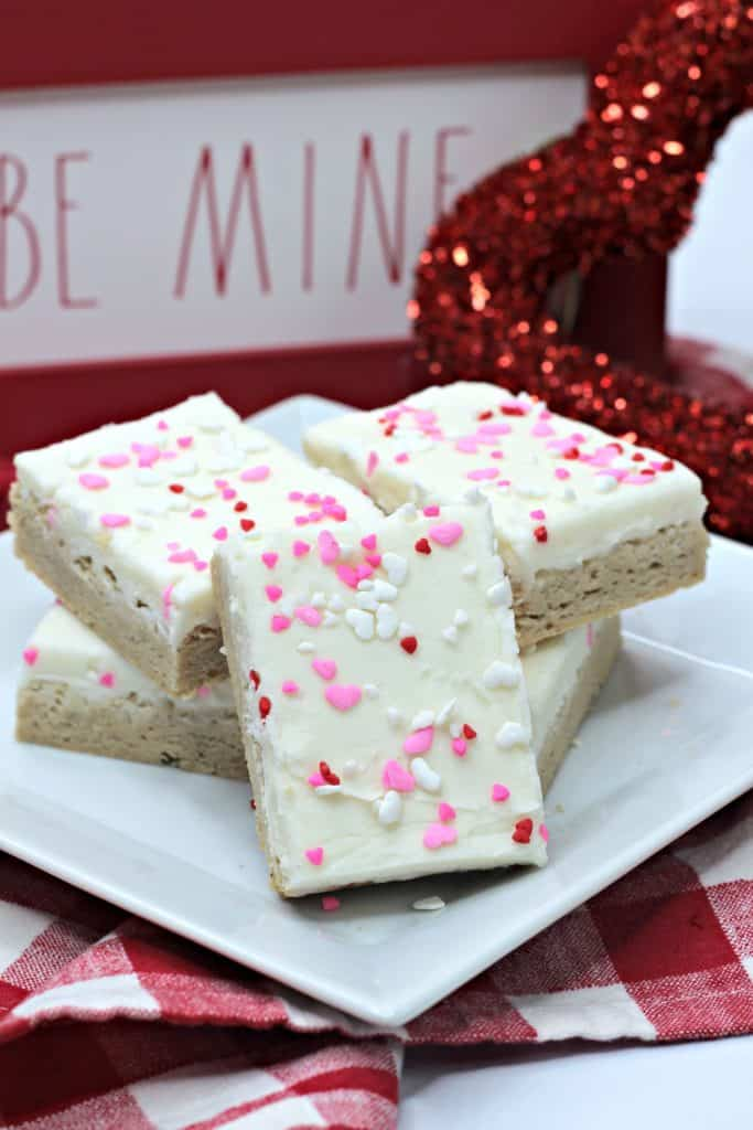 These yummy Valentine's Day snickerdoodle bars with cream cheese frosting are a huge hit with kids and grown ups.